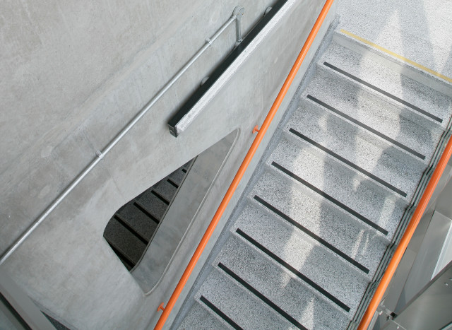 Main stair in concrete and terrazzo.