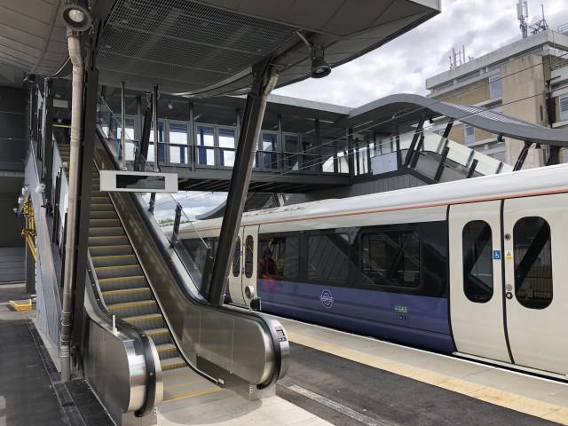 Crossrail Elizabeth line train on platform 3 at Abbey Wood Station.  New Central Interchange Footbridge with escalators.