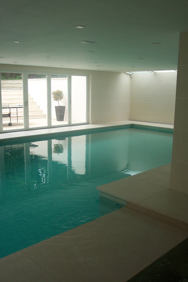 Swimming pool with doors to steps up to garden