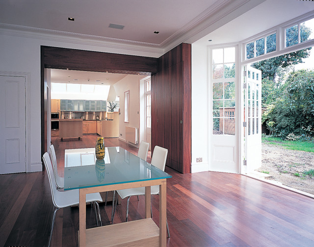 Open plan kitchen and dining area with separating doors