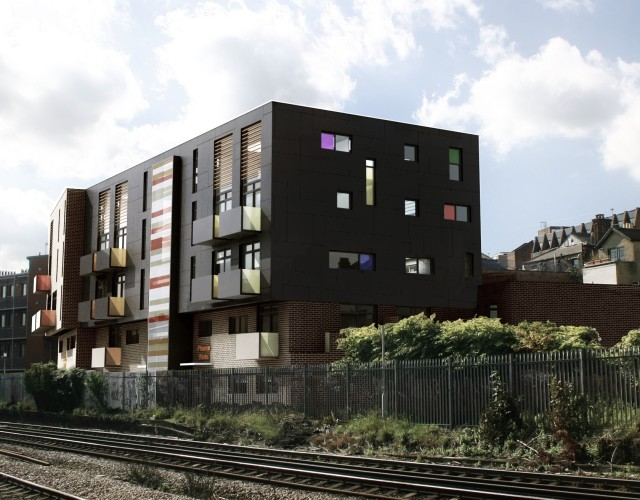 Image of New build mixed use development incorporating 30 social housing residential units and commercial B1 space on a tight, derelict, inner city piece of railway land in Lewisham, south London carefully designed to maximise the yield of the site in both plan and height